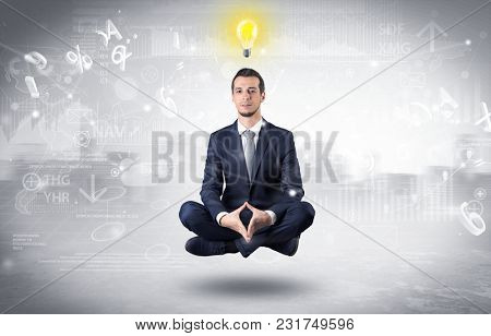 Businessman meditates with enlightenment data reports and financial concept