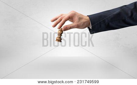 Big elegant hand taking his next step on chess game