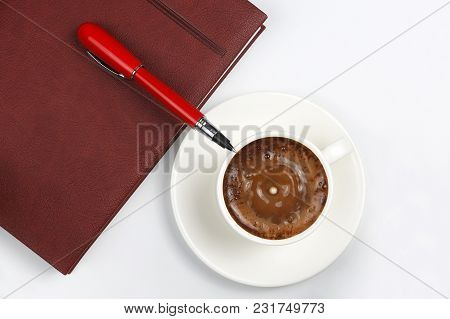 Notepad, Pen And Coffee Cup On White Background