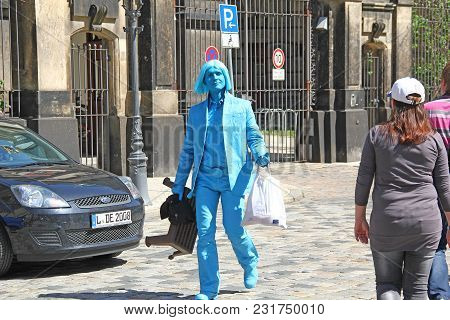 Dresden, Germany - April 27, 2012: An Unidentified Street Artist Goes In A Blue Makeup On The Street