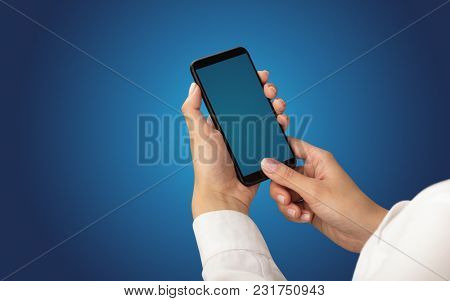 Mockup for female hand using frameless smartphone with dark background