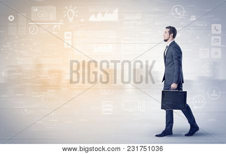 Handsome businessman walking in suit with briefcase on his hand and database concept around
