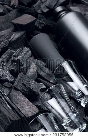 Black Set Of Matte Bottle Of Alcohol And Shot Glasses. On Charcoal Background. Black Edition.creativ