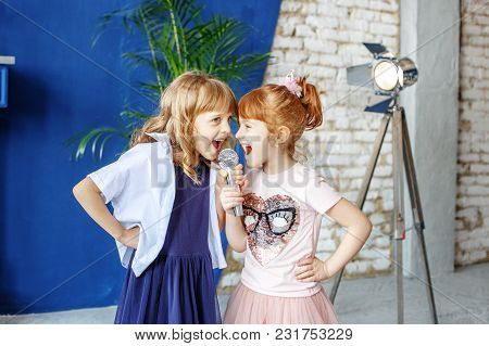 Two Little Funny Children Sing A Song In A Microphone. Group. The Concept Is Childhood, Lifestyle, M