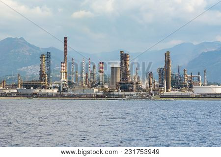 Industrial Zone In Milazzo Town On Sicily Seen From The Sea, Italy