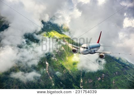 Aerial View Of Aircraft. Airplane Is Flying In Clouds