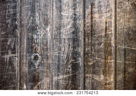 Fence Of Vertical, Tightly Fitted Old, Unpainted Boards With Wood Structure
