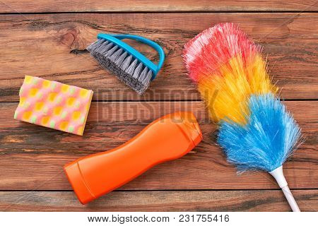 Supplies For House Cleaning On Wooden Background. House Cleaning Products On Wood Table. Keep Your H