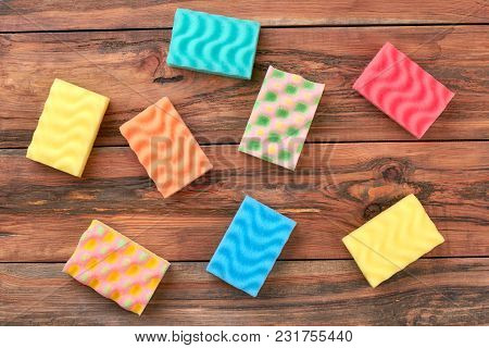 Set Of Multicolored Kitchen Cleaning Sponges. Group Of Different Colors Cleaning Sponges On Brown Wo