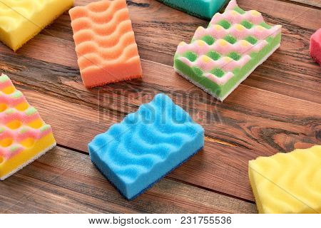Housekeeping Sponges On Wooden Background. Set Of Colorful Kitchen Sponges On Wooden Table. House Cl