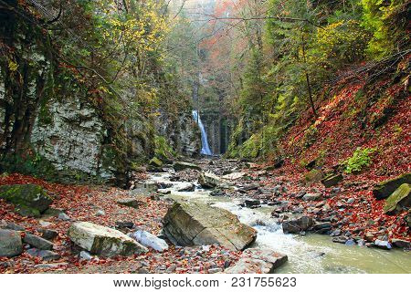 Waterfall In Mountain Ravine. Mountain River Turns Into Waterfall. Water Landscape In Forest. Fallin
