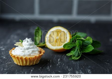 Sweet Tasty Cake, Mint And Lemon. The Concept Of Food, Desserts, Restaurant.sweet Tasty Cake, Mint A