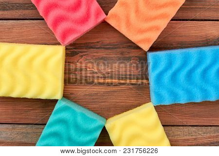Colorful Kitchen Sponges, Copy Space. Set Of Multicolored Sponges For Dish Washing On Wooden Backgro