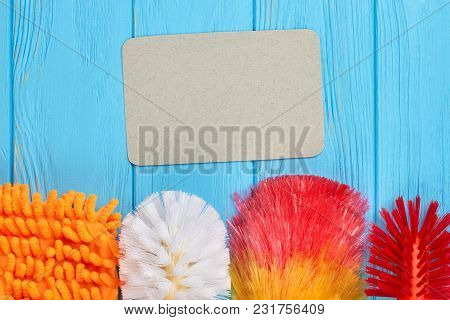 Spring Cleaning Equipment On Colorful Background. Set Of Multicolored Brushes For House Cleaning And