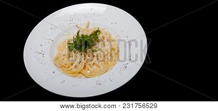 Carbonara Paste. Italian Cuisine. On A Black Background.copy Space