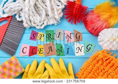 Set Of Cleaning Products On Colorful Background. Spring Cleaning Concept With Supplies On Wooden Tab