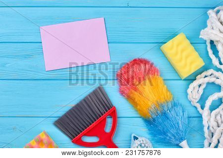 Items For Cleaning On Wooden Background. Clean Up Your House With Love. Clean Home - Clean Mind.