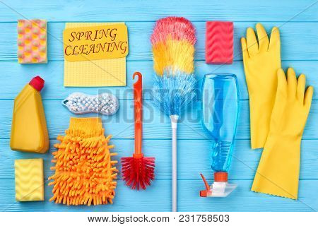 Spring Cleaning Wooden Background. Colorful Equipment For House Cleaning On Colored Background. How