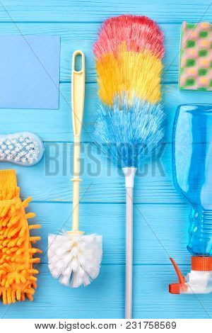 Set Of Cleaning Equipment On A Wooden Background. Set Of Variety Cleaning Supplies On Wooden Table.