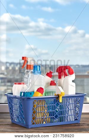 Basket With Cleaning Supplies. Spring Cleaning Concept With Supplies, Window Sky Background. Househo