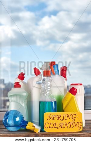 Variety Of Bottles With Cleaning Liquid. House Cleaning Products On Window Sky Background. Make Your
