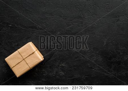 Delivery Service Office With Cardboard Box For Courier On Dark Desk Background Top View Mock-up