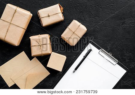 Parcels Box Delivery On Black Table Background Top View Mock Up