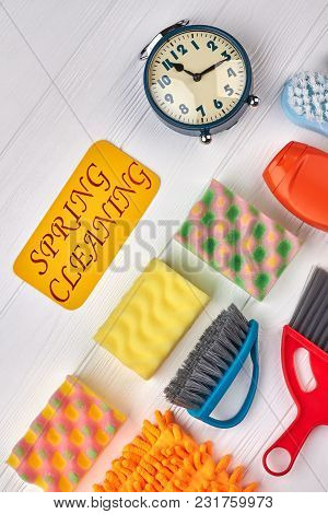 House Cleaning Supplies, Top View. Set Of Sponges And Brushes For Spring Cleaning. Mechanical Alarm
