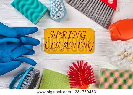 Spring Cleaning Background With Supplies. Cleaning Items And Tools On Wooden Background. Spring Clea