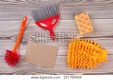 House Cleaning Items On Wooden Background. House Cleaning Supplies. Preparation For Spring Cleaning.