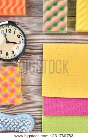 Cleaning Supplies Wooden Background, Top View. Kitchen Sponges, Cellulose Napkin Rags, Brush And Ala