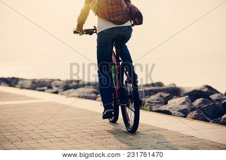 One Woman Cyclist Riding Bike On Seaside