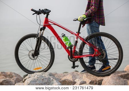 Woman Cyclist With Mountain Bike On Seaside