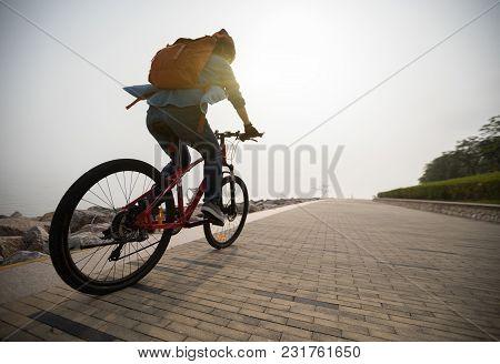 Cyclist Riding Mountain Bike In The Sunrise Coast