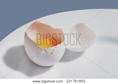 Close-up Of Chicken Egg On A White Plate.