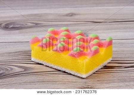 Close Up Kitchen Sponge On Wooden Background. Sponge For Washing Dishes Close Up.