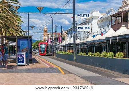 Glenelg, Australia - November 13, 2017: Bright Red Tramway On Streets Of Glenelg Toan, South Austral