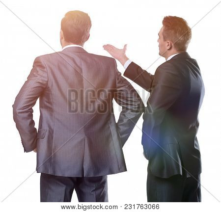 rear view of two businessmen pointing forward