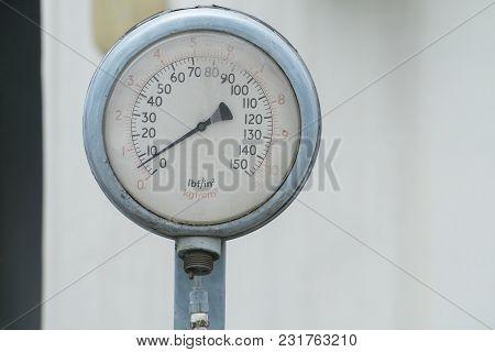 Old Blue Pressure Gauge On Day Ligth