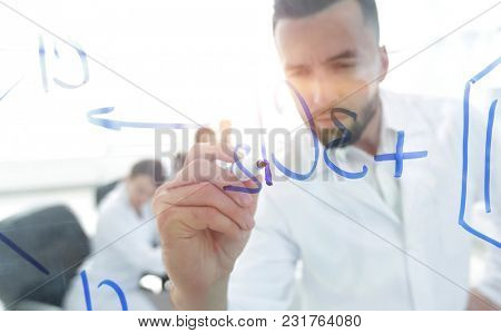 close up of a Man scientist working with formulas