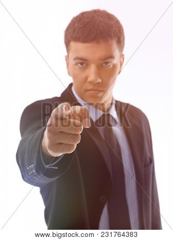 serious businessman pointing his finger forward