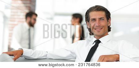 portrait of pensive businessman on blurred background.