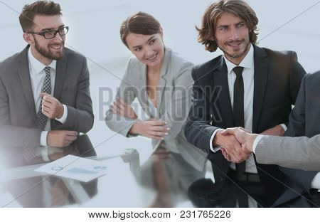 handshake partners at a business meeting