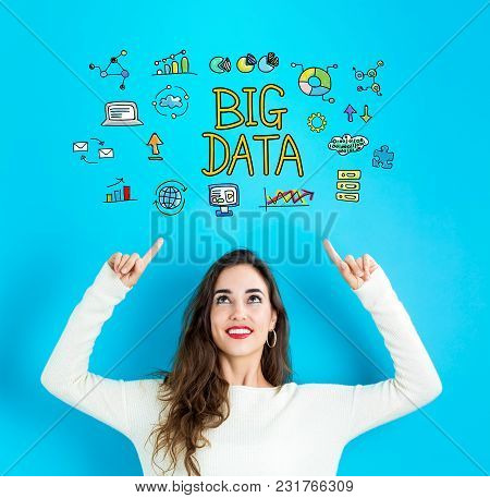 Big Data With Young Woman Reaching And Looking Upwards