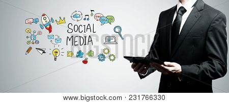 Social Media With Man Holding A Tablet Computer