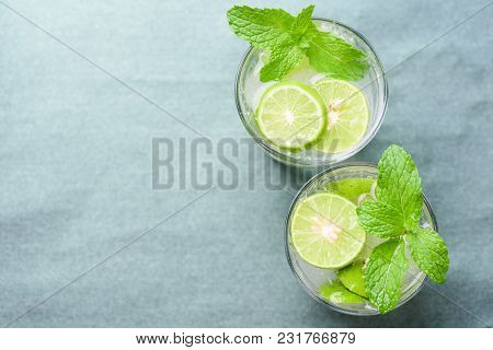 Glass Of Iced Lemonade Soda With Slice Lime And Mint Leaves, Cold Drink In Summer, Top View