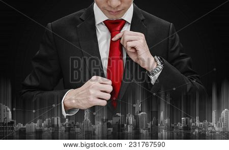 Businessman Tying Red Necktie And Raising Graph Diagram With Building Technology. Business Growth An