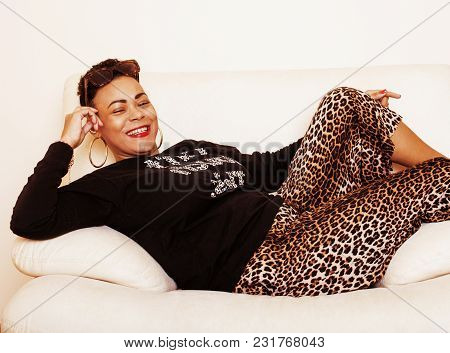 poster of pretty stylish african american big mama woman well dressed. swag relax at home, leopard print on clothers. fashion look close up