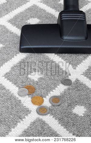 Vacuum Cleaner And Coins On Gray Carpet (canadian Money).
