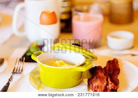 Delicious Breakfast With Scrambled Eggs And Bacon